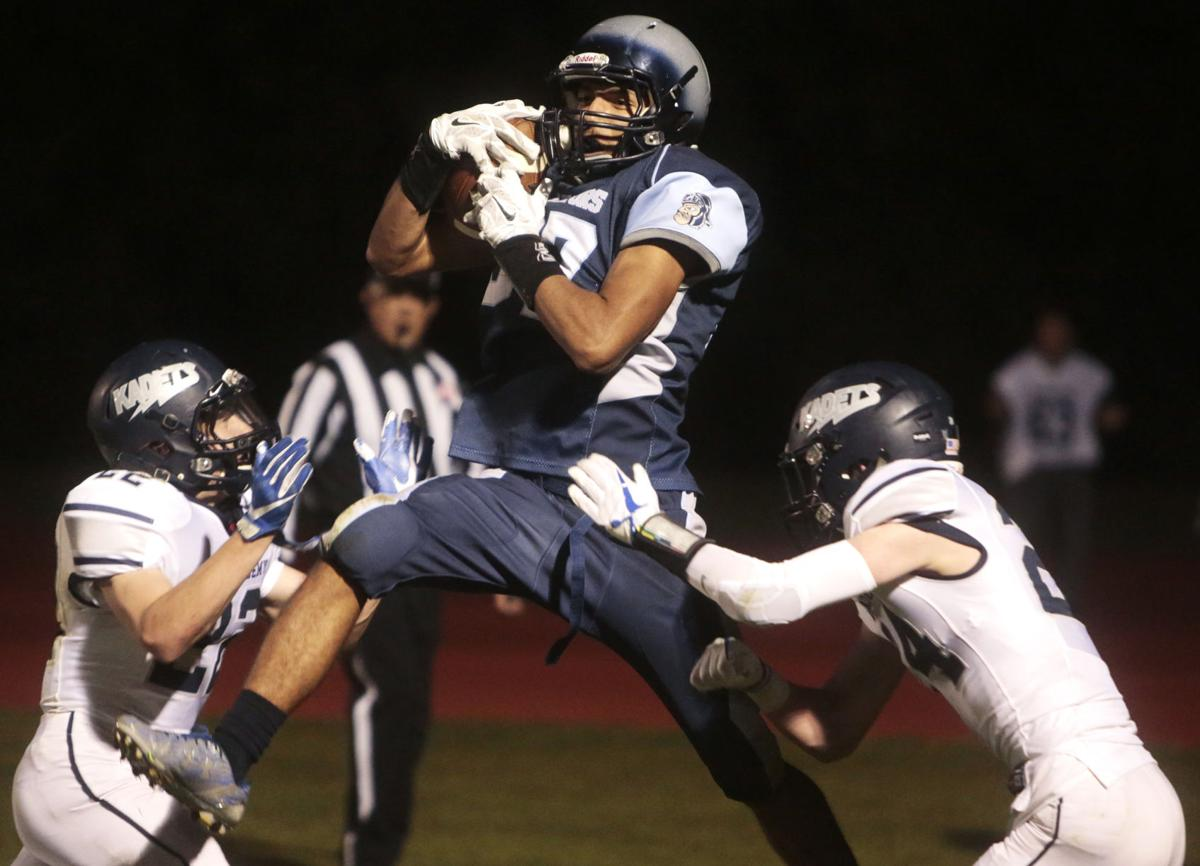 Widefield junior Luis Maldonado catches a pass for a two-point conversion at Widefield's CA Foster stadium on Friday, Oct. 13, 2017. Widefield defeated the Air Academy Kadets 28-24. (The Gazette, Nadav Soroker)
