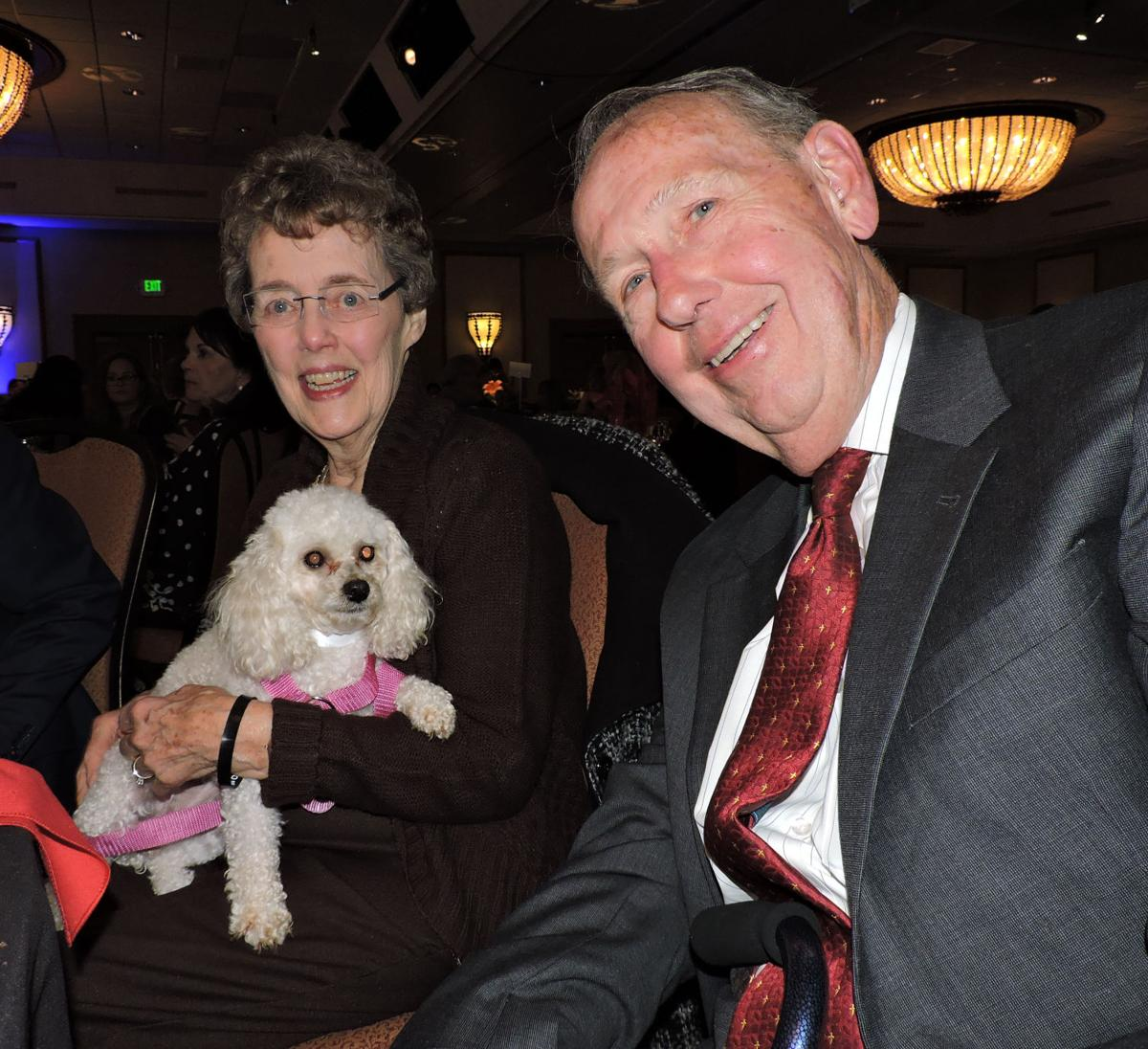 Mary Anne and David Wismer had a visitor at their table, Peaches, a National Mill Dog Rescue resident. The Wismers were honored for The Timothy Center, the rescue's new veterinary clinic and rehab center, named for their beloved shih tzu. 101417 Photo by Linda Navarro