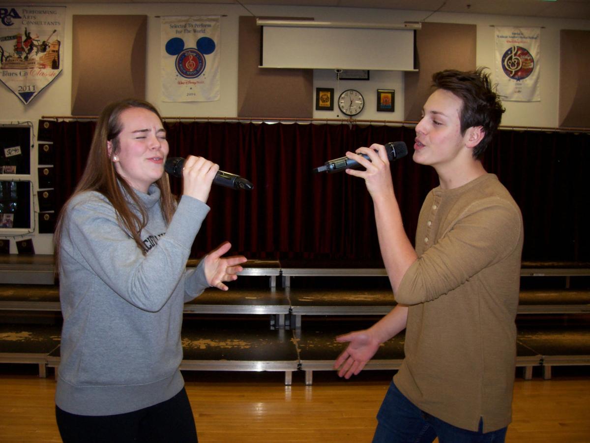 Lexi Carlson and Julian Webber-Romanos sing a harmonic duet
