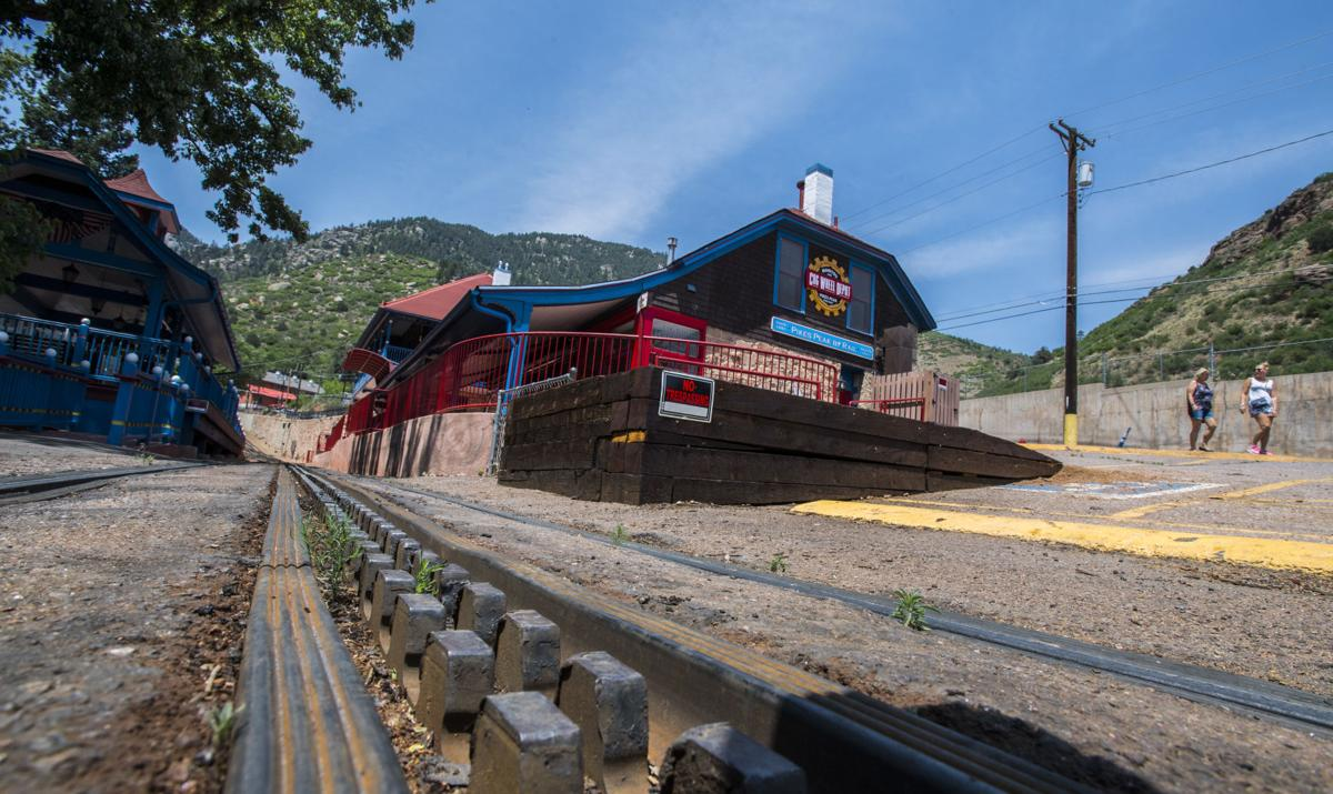 Tourists walk past the closed depot Tuesday, June 12, 2018, at The Pikes Peak Cog Railroad in Manitou Springs. After 126 year of operation the train to the summit of Pikes Peak didn't open for the summer because of needed repairs to the trains and tracks. The railway, whose future as an iconic tourist attraction has been in doubt since its closing late last year, will be rebuilt and reopened if its owner and the city of Manitou Springs sign a proposed agreement. (The Gazette, Christian Murdock)