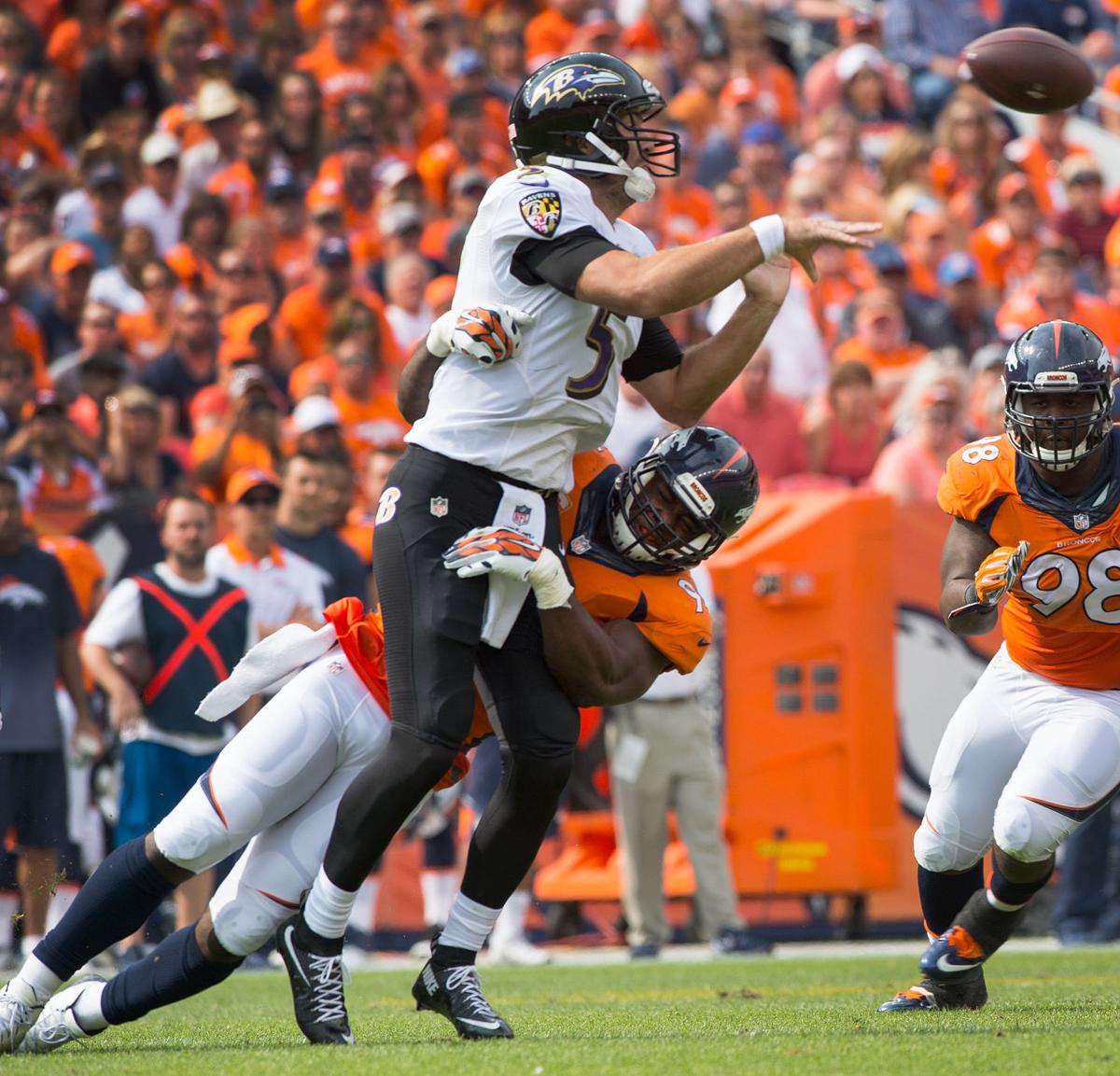 Denver linebacker DeMarcus Ware hits Baltimore quarterback Joe Flacco as he attempts a pass during the second quarter Sunday, Sept. 13, 2015, at Sports Authority Field at Mile High in Denver. (The Gazette, Christian Murdock)