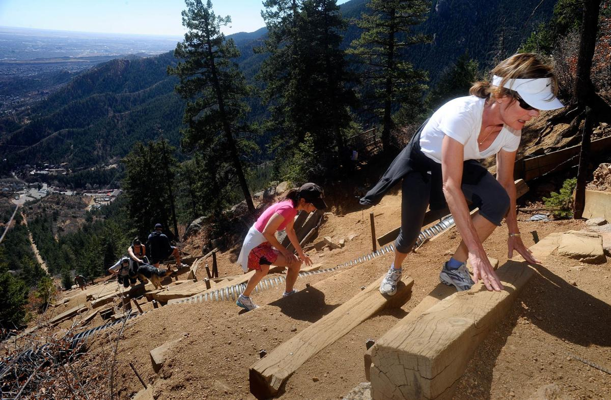 Anne Beach, right, and Lisa Bruinsma of Colorado Springs make their way up the Manitou Springs Incline Friday, April 8, 2011. They try to tackle the mile hike with about 2,000 feet of elevation gain at least once a week. The climb Friday was Bruinsma's 30 trip up the mountain this year. ( The Gazette, Christian Murdock)