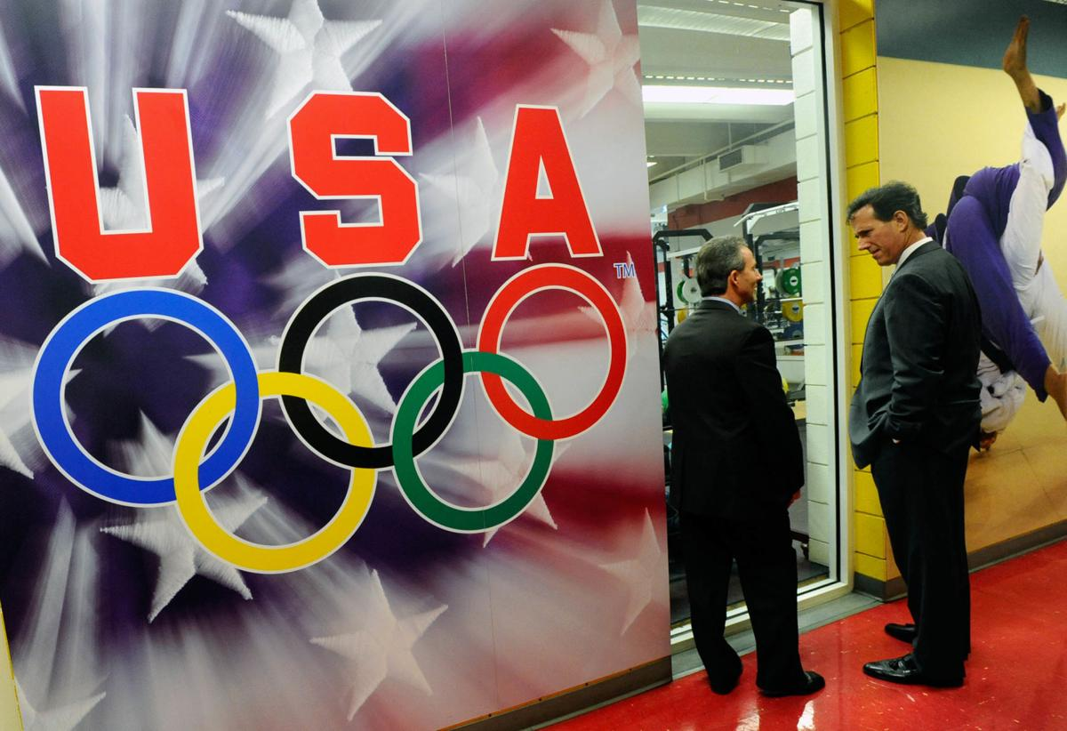 Mike English, the USOC Chief of Sports Performance, left, shows former Sen. Rick Santorum, R-Penn., the weight room Wednesday, April 6, 2011, while touring the Olympic Training Center. ( The Gazette, Christian Murdock)