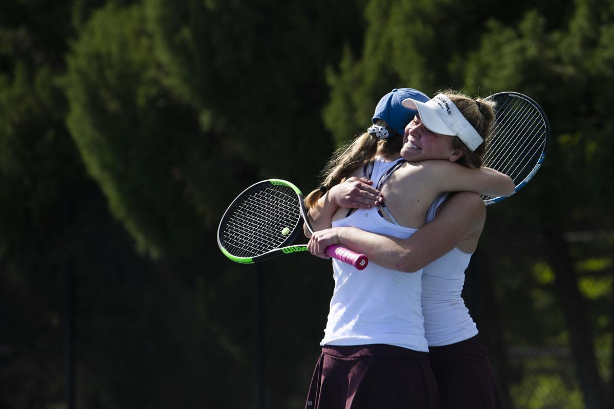 (CHEYENNE) Cheyenne Mountain senior Sydney Wagner hugs her doubles partner, sophomore Emma Delich