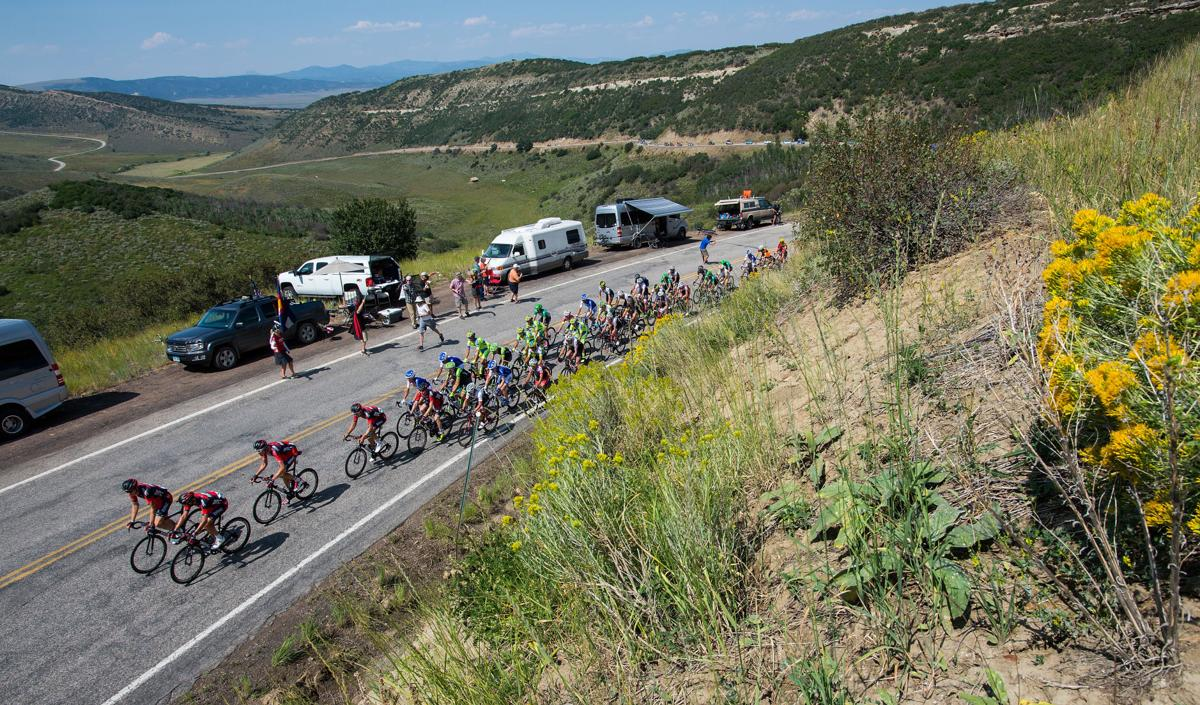 Riders climb the hill toward the King of the Mountain spot along Highway 33 Monday, Aug. 17, 2015, during Stage 1 of the 2015 USA Pro Challenge in Steamboat Springs, Colo. Stage 1 is a two-lap, 97 miles circuit beginning and ending in Steamboat Springs. (The Gazette, Christian Murdock)