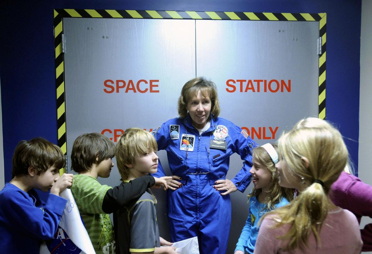 Flight Director Merry Bartek and a group of Colorado Springs School third graders