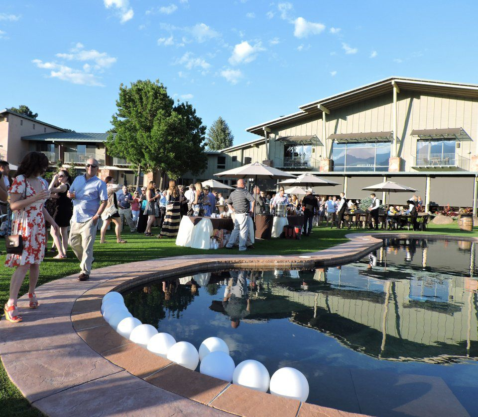 Enchanted Weekend On the Mesa: Guests stroll around the pool at Garden of the Gods Club, trying samples from local chefs and wine and whiskey tastings. 081817 Photo by Linda Navarro