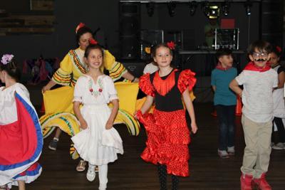 Global Village Academy students perform at Fiesta Salsa celebration at school