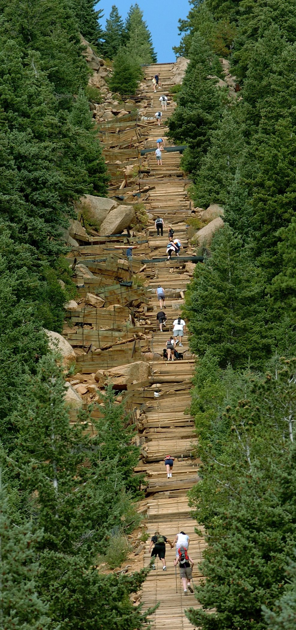 Hikers climb Incline toward the top of Mount Manitou in Manitou Springs Saturday Sept. 10, 2005. The hike has an average grade of 41 percent with the steepest being 68 percent. Photo by Christian Murdock/The Gazette