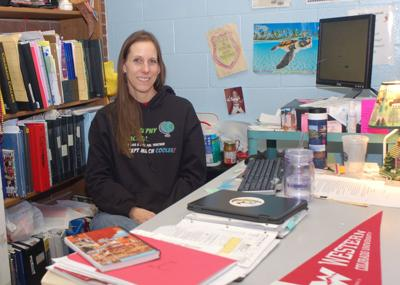 Mel Johnson, a geography teacher, is pictured at her desk at Coronado High School