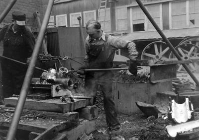 Pouring molten metal at the Golden Cycle Mill