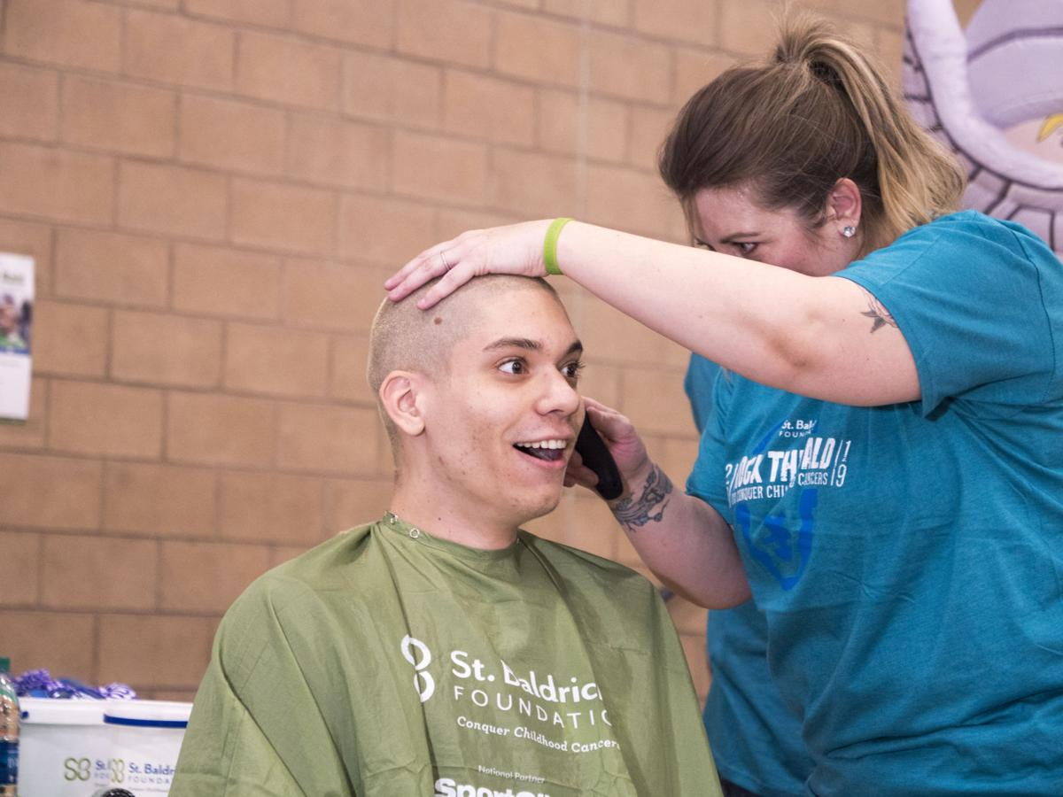 DCC students brave the shave for childhood cancer research