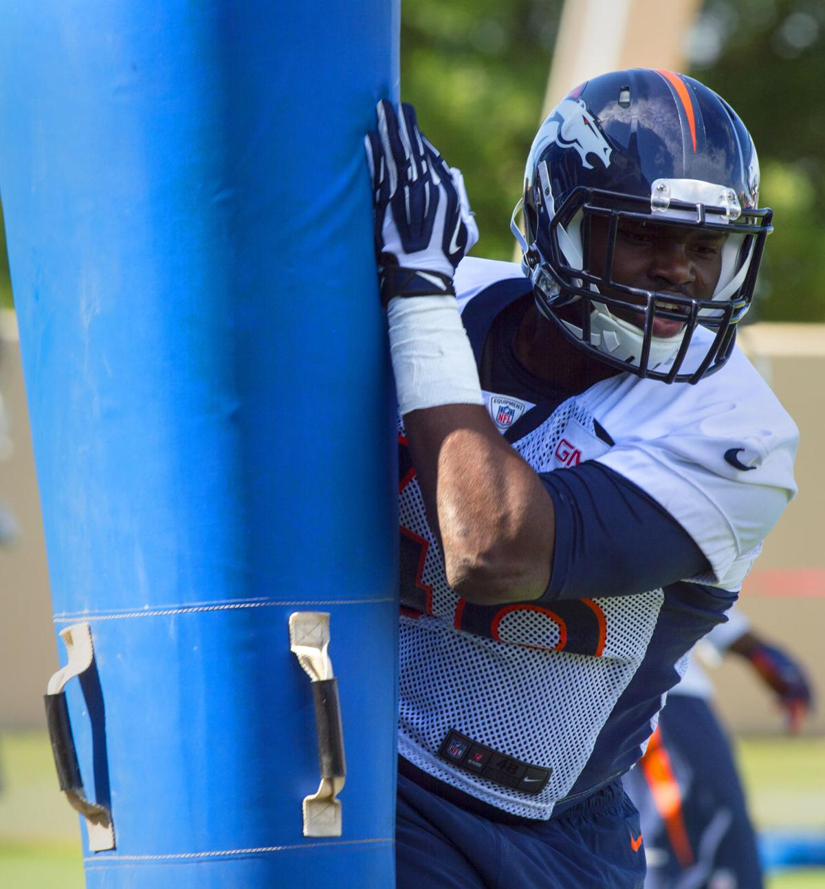 Rookie linebacker Shaquil Barrett from Colorado State runs through drills Thursday, July 24, 2014, during the first day of training camp at the Broncos Headquarters in Englewood, Colo. (The Gazette, Christian Murdock)