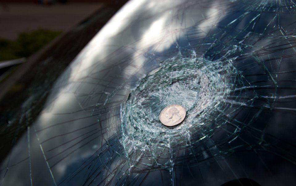 Hail the size of a baseball damaged more than two dozen police vehicles Thursday night, July 28, 2016, at the Stetson Hills police station in Colorado Springs. (The Gazette, Christian Murdock)