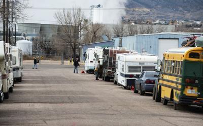 RV campers park alongside a road near City Gate in Colorado Springs