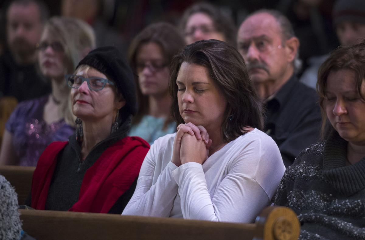 Deb Walker, right, listens to a speaker Saturday, Nov. 28, 2015, during a vigil at the All Souls Unitarian Universalist Church in downtown Colorado Springs for the three killed in the shooting at the Planned Parenthood clinic Friday, Nov. 27, 2015. (The Gazette, Christian Murdock)