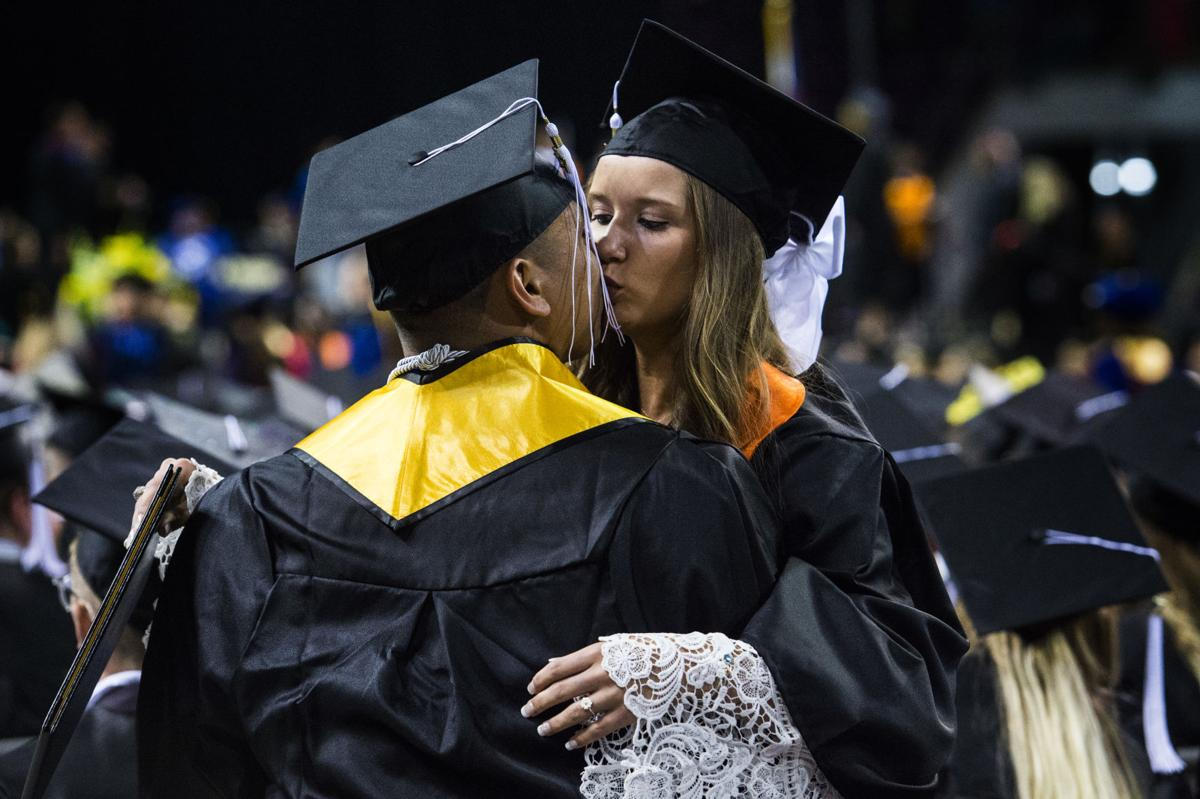 Micaela Scapin kisses her boyfriend, David Duarte, after they received their diplomas during the University of Colorado at Colorado Springs' morning commencement ceremonies Friday, May 12, 2017, at the Broadmoor World Arena in Colorado Springs. The couple met each other their freshman year at UCCS. A record 1,532 students received their degrees this Spring.  (The Gazette, Christian Murdock)