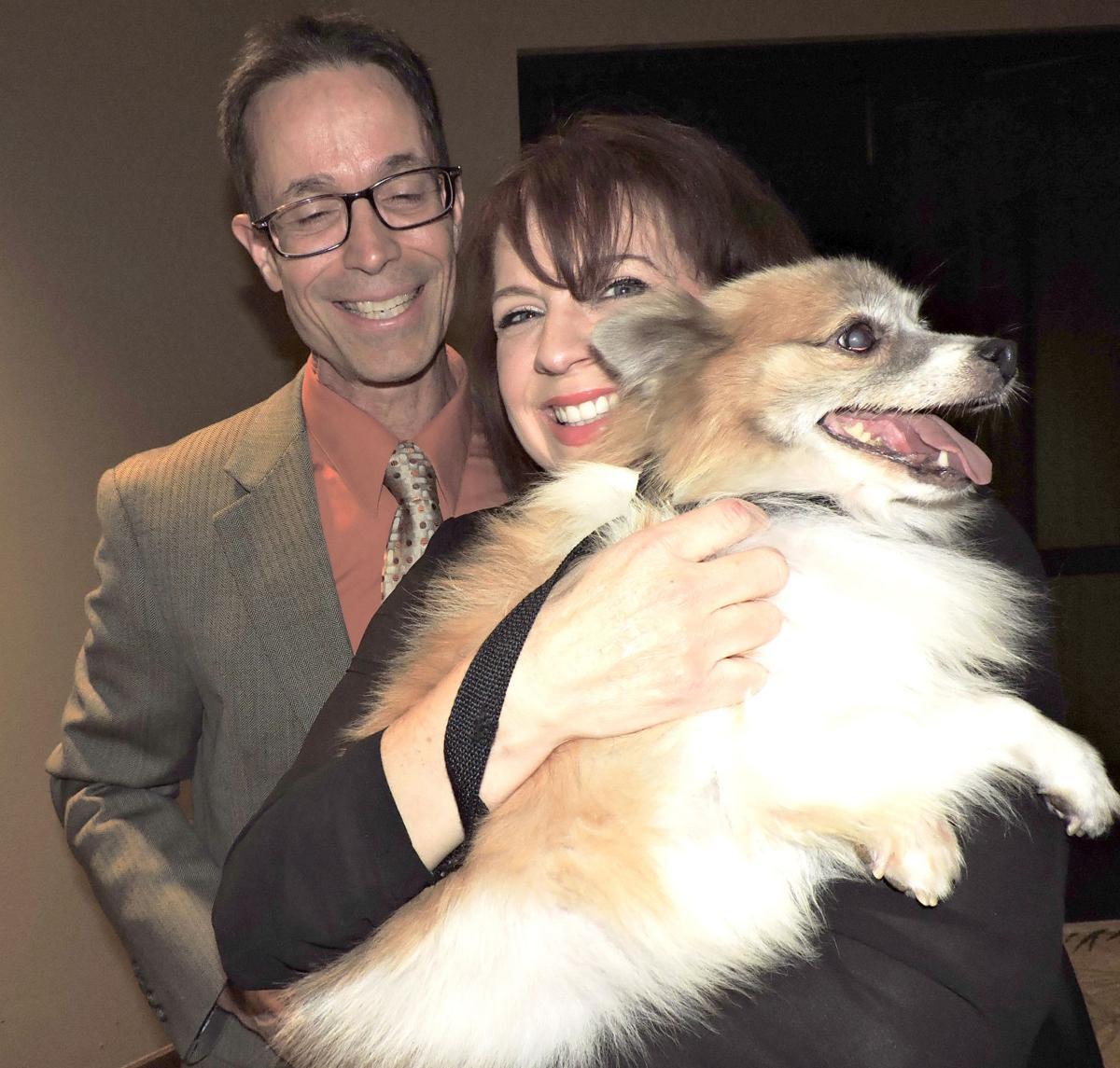 National Mill Dog Rescue benefit gala: Mike Howington and Melissa Davis meet Layla. 101417 Photo by Linda Navarro