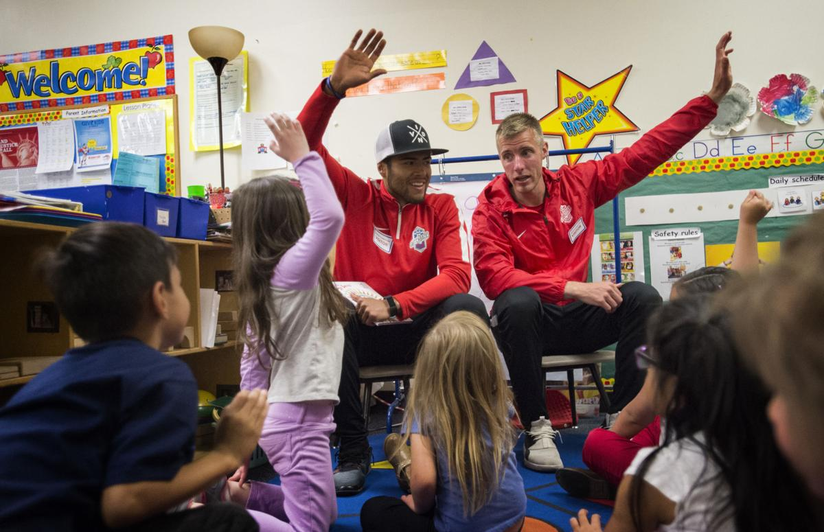 "Switchback players Rony Argueta, left, and Eddy Prugh asks questions before reading Dr. Seuss' ""Oh the thinks you can think !"" to students Thursday, April 27, 2017, while visiting the headstart class at Carver Elementary School in Colorado Springs. (The Gazette, Christian Murdock)"