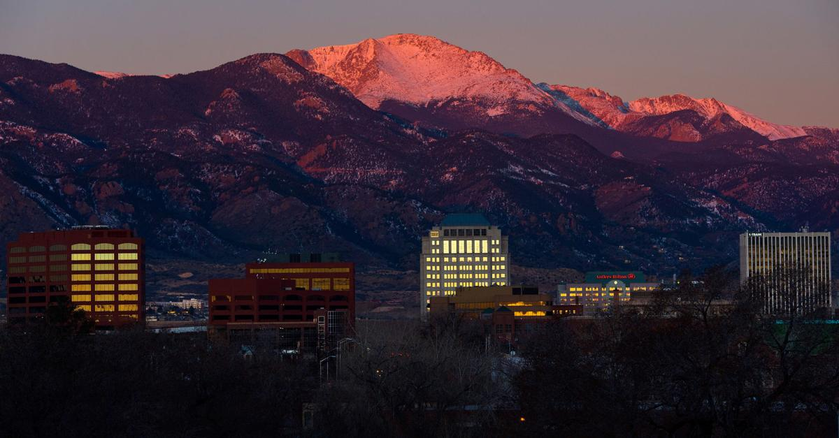 The sun rises over downtown Colorado Springs Friday, Feb. 13, 2015. (The Gazette, Christian Murdock)