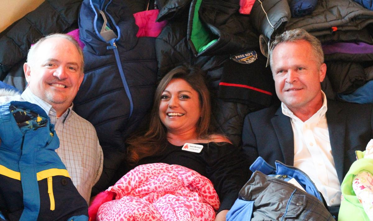 Koats 4 Kids sponsors from The O'Neil Group Co. were surrounded by new coats: from left, Maury Keller, Tammy Mondragon, Ron Voss. PHOTO COURTESY KOATS 4 KIDS