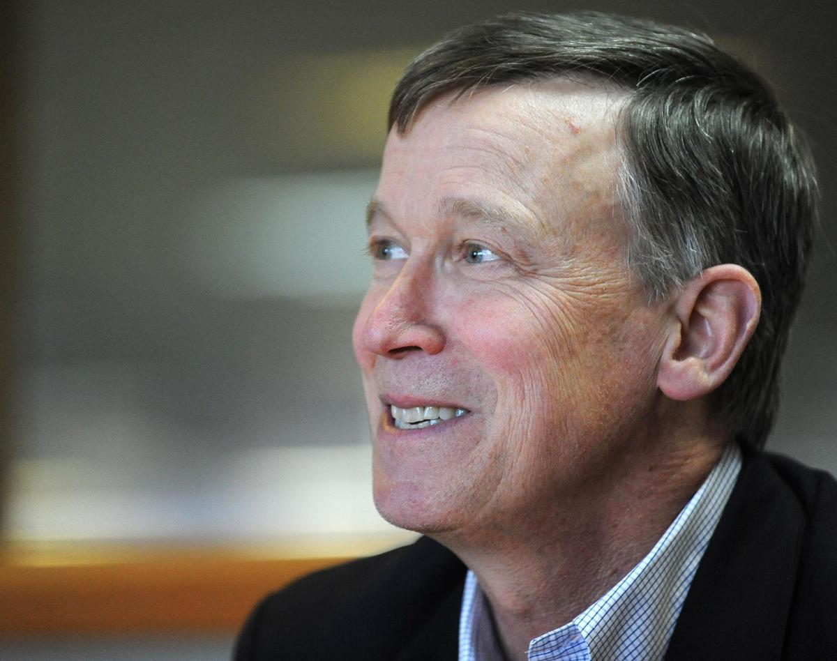 Gov. John Hickenlooper speaks to member of The Gazette newsroom, Thursday, Oct. 27, 2011. (The Gazette, Christian Murdock)