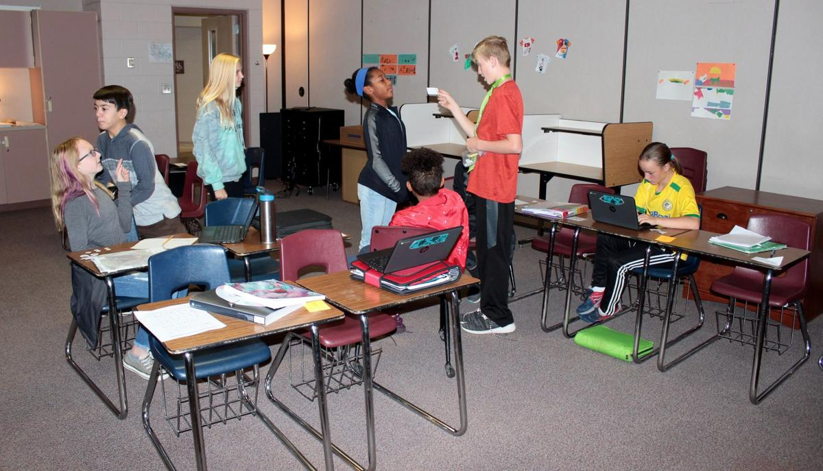 seventh-grade history class at Woodland Park Middle School learn
