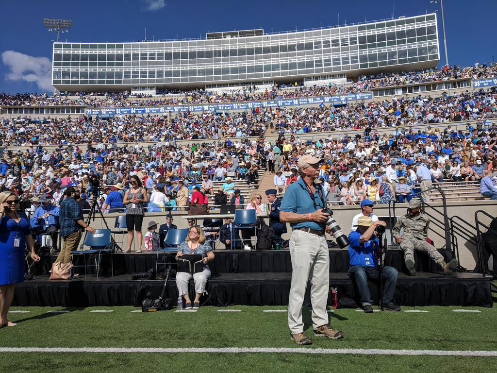 Media members prepare as the stands fill at Falcon Stadium for the 2018 Air Force Academy graduation. Photo by Tony Peck, The Gazette.
