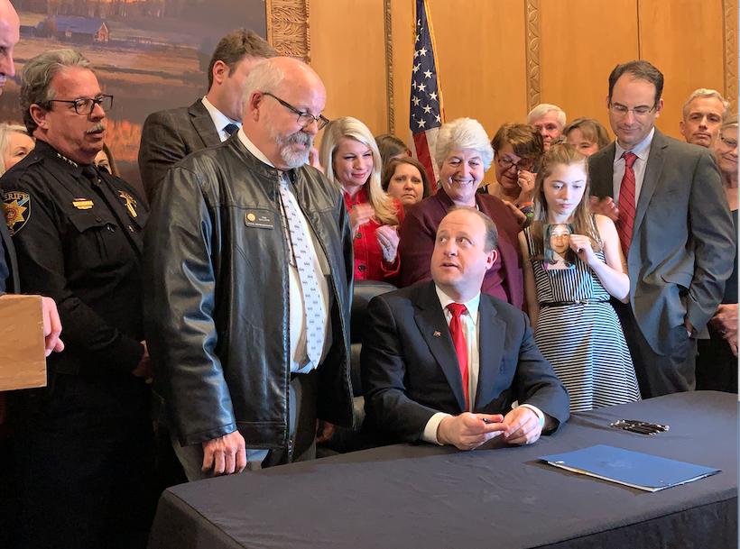 Gov. Jared Polis signs red flag law