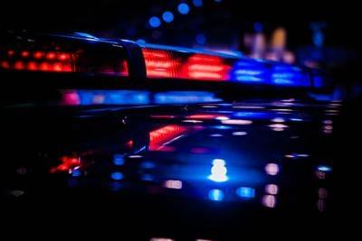 Emergency warning red and blue roof mounted police LED blinker light bar turned on