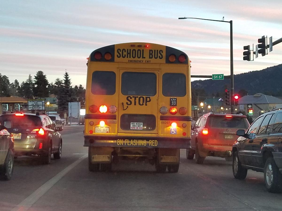Kids and coats, school bus