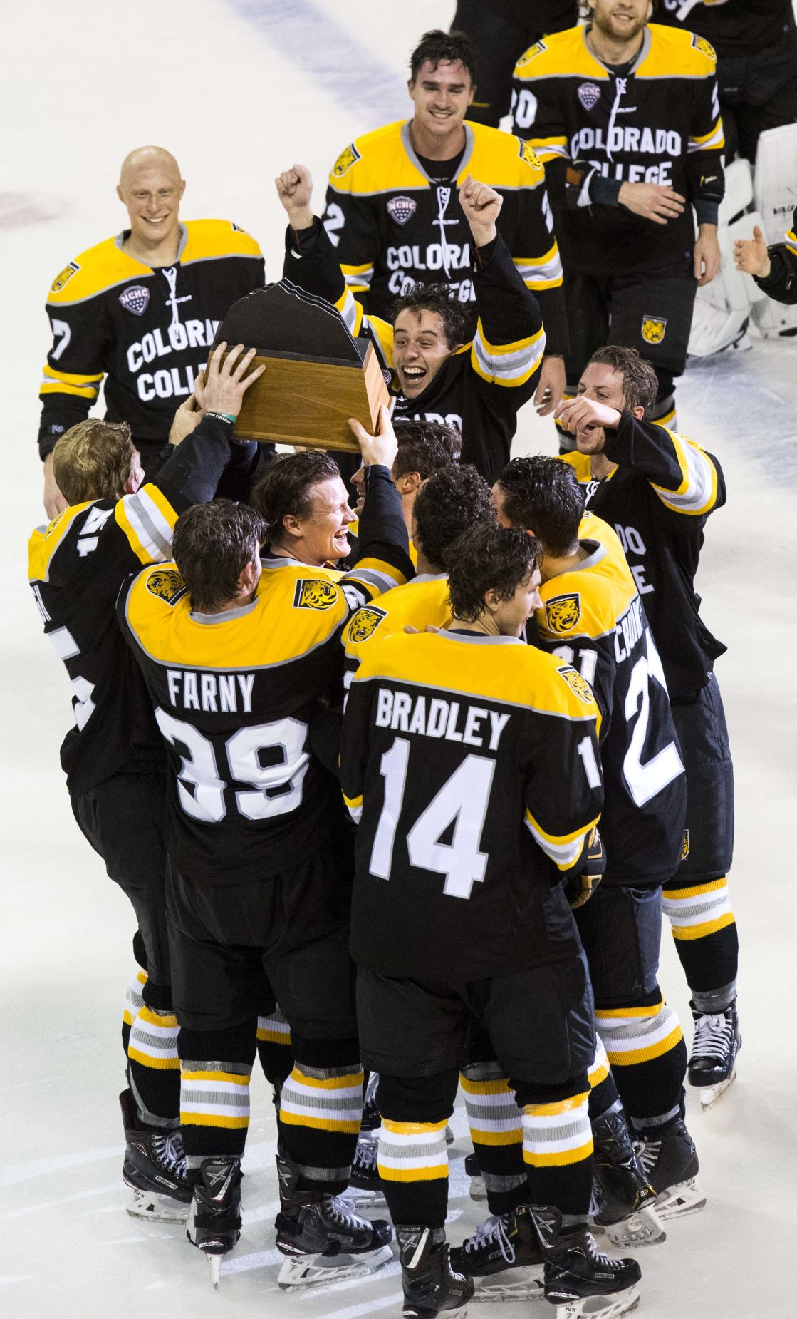 Colorado College Players Take Good Care Of Pikes Peak Trophy
