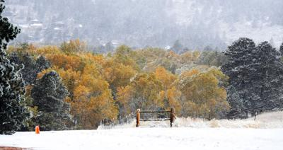 Winter in autumn as snow falls across Front Range