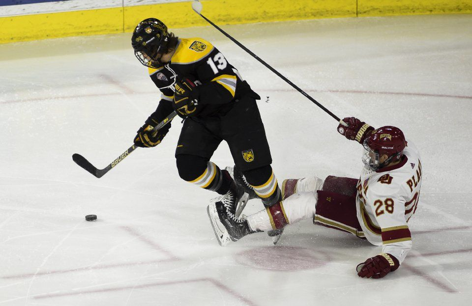 Colorado College forward Nick Halloran tries to take control of the puck as he tangles with University of Denver defender Adam Plant at the Magness Arena on Saturday, March 10, 2018. The University of Denver won 3-2 to tie up the series 1-1, with a tiebreaker game Sunday. (Nadav Soroker, The Gazette)