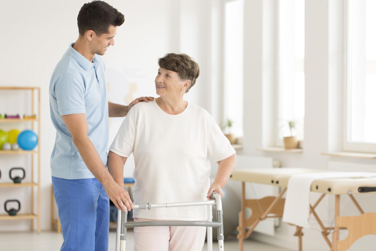 Elderly ward using walking frame