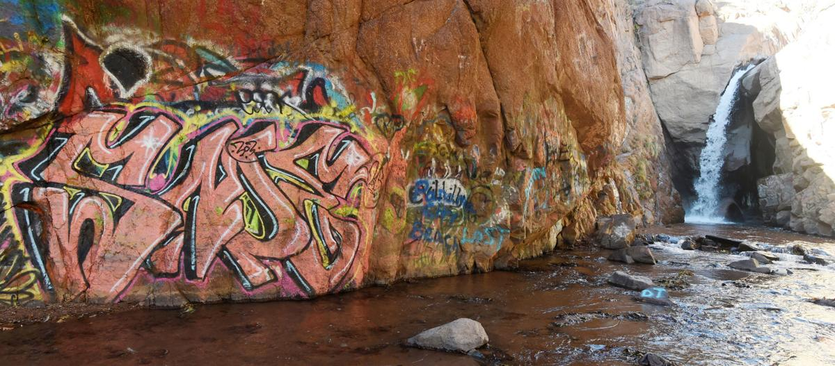 The Rainbow Falls bridge will be undergoing repairs in the next few months. El Paso County and CDOT are going to examine ways that the bridge might redesigned to deter graffiti. Graffiti lines the walls of the rocks next to the bridge on Friday, November 20, 2015. (Jerilee Bennett/The Gazette)