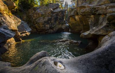 A sole aspen leaf lies in a puddle on the rocks surrounding the Grottos on the Roaring Fork River near Aspen, Colo. Tuesday, Sept. 19, 2017. (The Gazette, Christian Murdock)