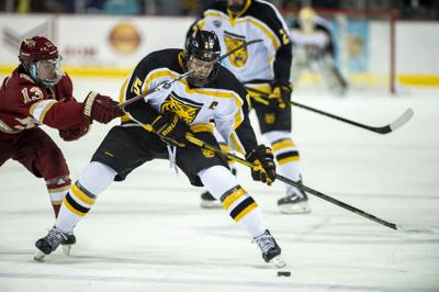 Colorado College Hockey Downs No 6 Denver Ensures Gold Pan Hinges