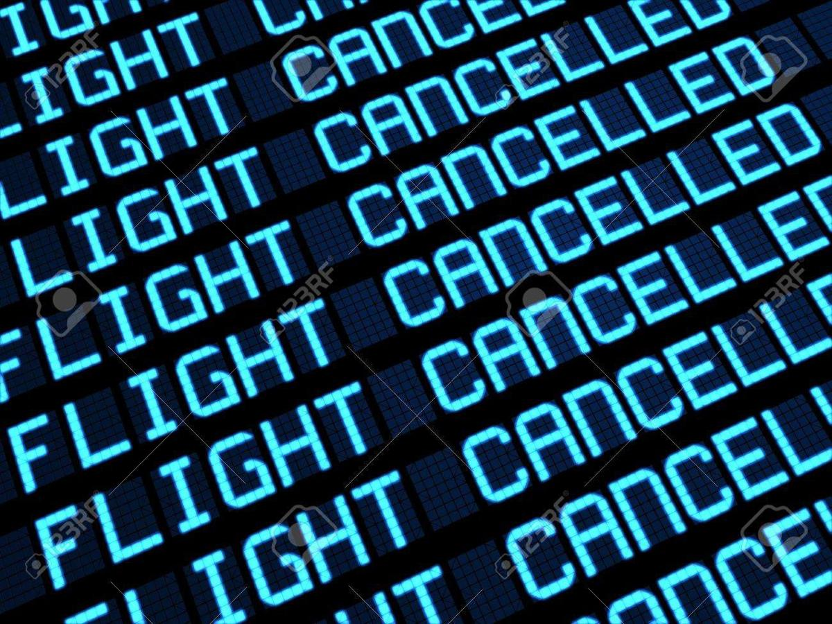 14841389-departures-board-at-airport-terminal-showing-cancelled-flights-because-of-strike-travel-unforeseen-c.jpg