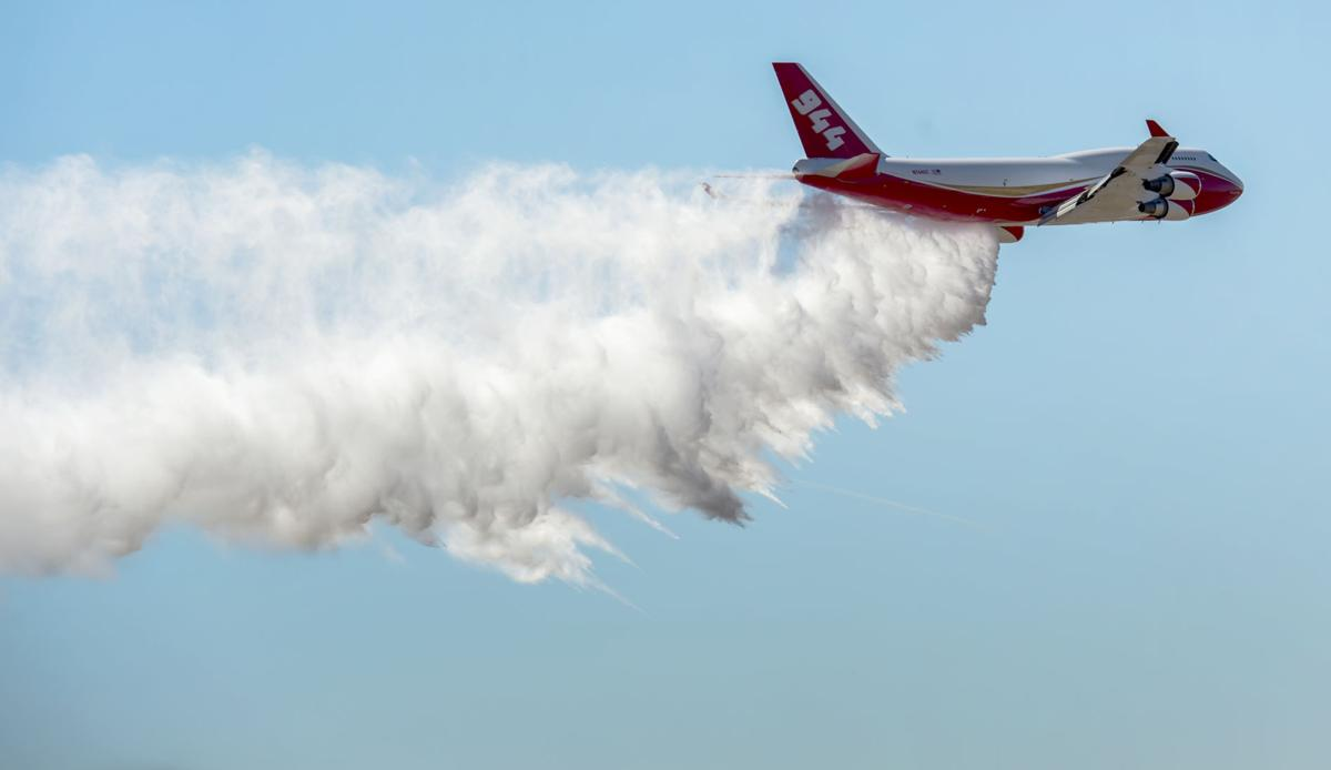 The Boeing 747-400 Global SuperTanker drops half a load of it's 19,400-gallon capacity during a ceremony Thursday, May 5, 2016, at the Colorado Springs Airport demonstrating the firefighting capabilities of the world's largest firefighting plane. The Spirit of John Muir plane will be stationed out of the Colorado Springs Airport and will be able to respond to fires around the world. (The Gazette, Christian Murdock)