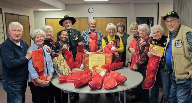Black Forest AARP Chapter members donate filled stockings