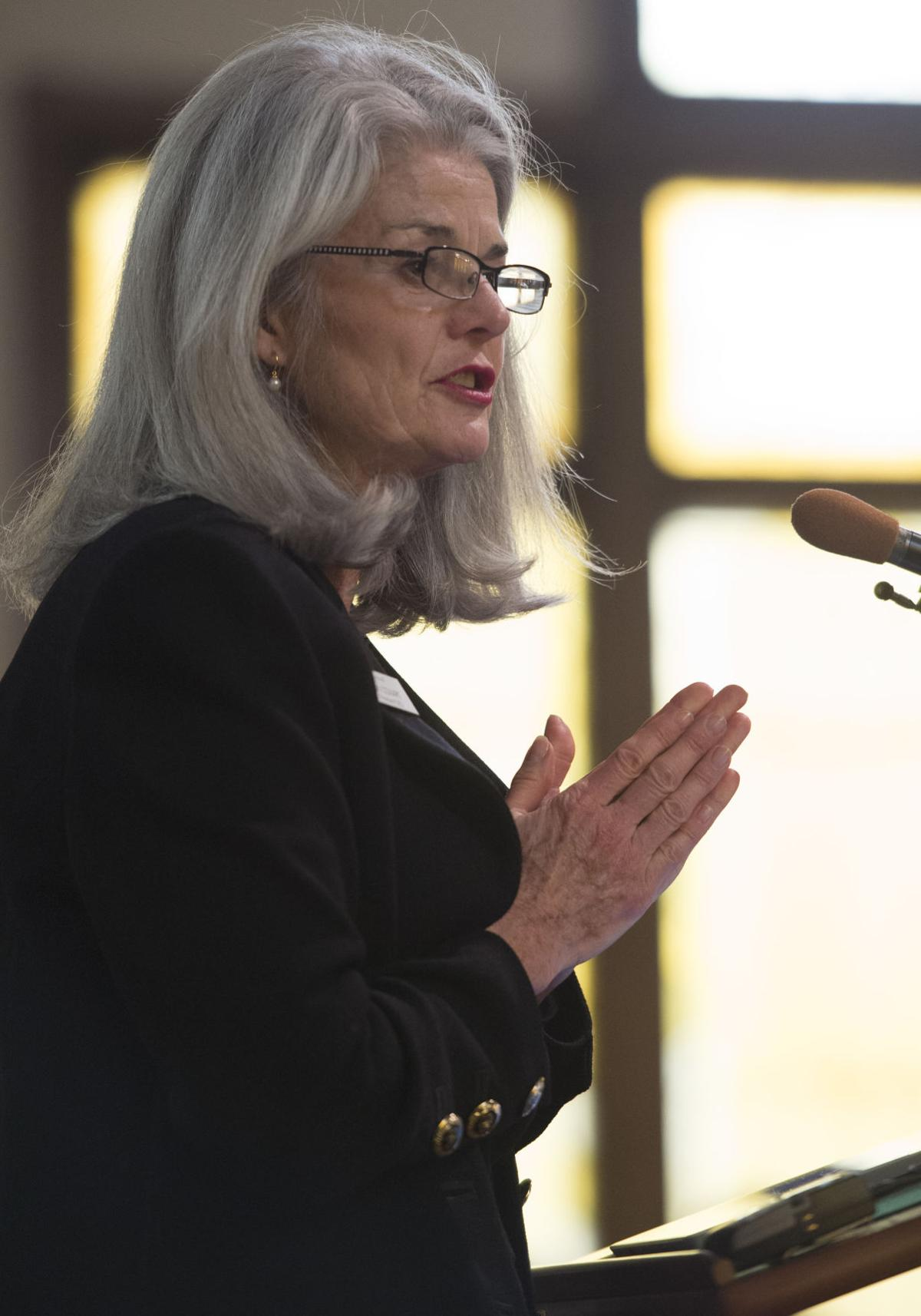 Vicki Cowart, the president and CEO of Planned Parenthood of the Rocky Mountians, speaks Saturday, Nov. 28, 2015, during a vigil at the All Souls Unitarian Universalist Church in downtown Colorado Springs for the three killed in the shooting at the Planned Parenthood clinic Friday, Nov. 27, 2015. (The Gazette, Christian Murdock)