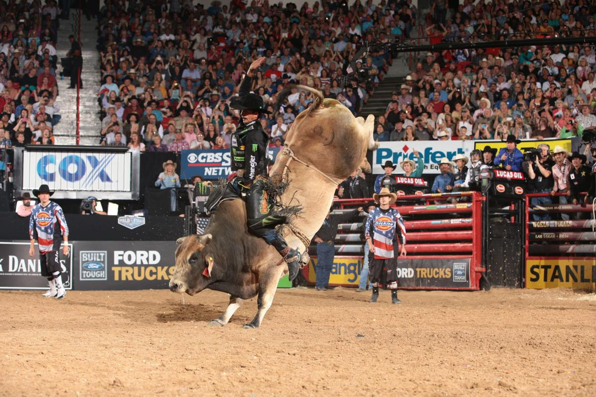JB Mauney rides D&H/Buck's Bruiser for 93.25 during the fourth round of the 2014 Built Ford Tough Series PBR. Photo by Andy Watson