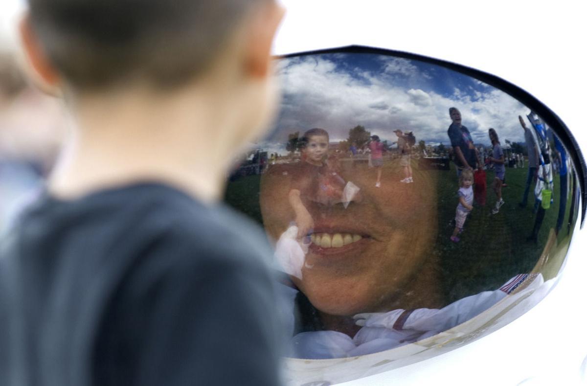 Joshua Burkhart shakes hands with Merry Bartek, flight director at The Challenger Learning Center