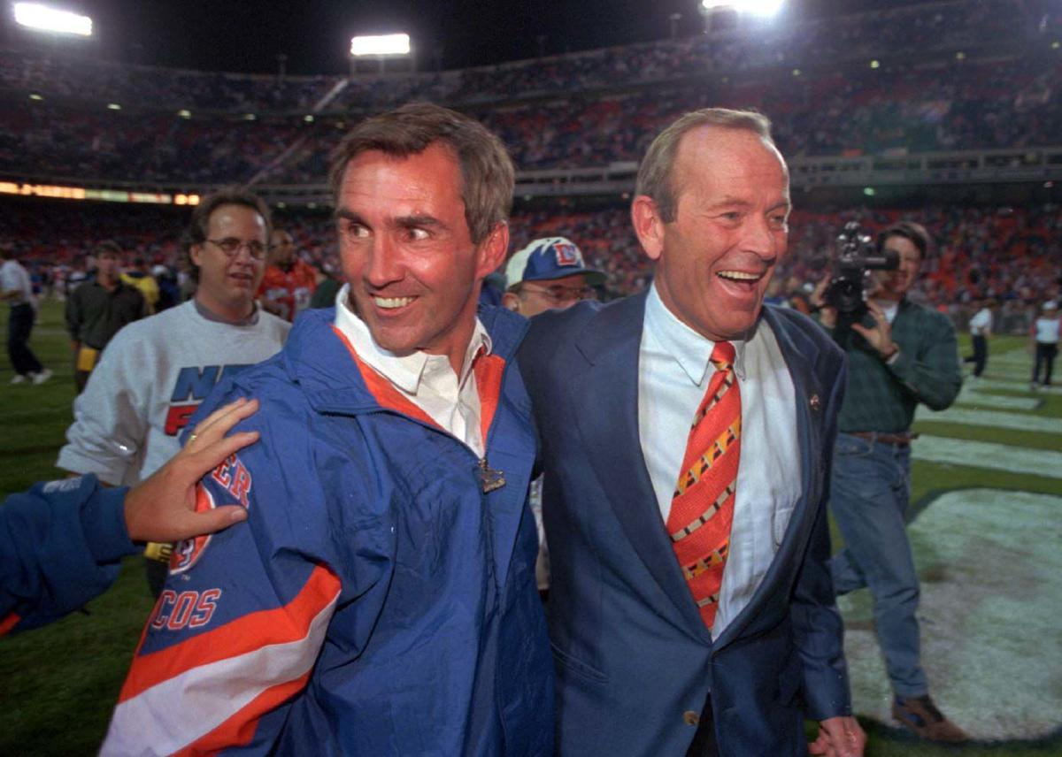 Mike Shanahan and Broncos owner Pat Bowlen leave the field arm-in-arm following the Broncos' 27-0 shutout of the LA Raiders Monday night. Reis photo