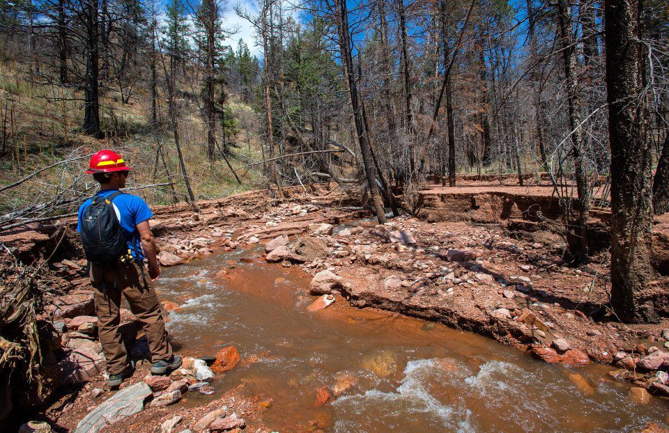 Joe Lavorini of Rocky Mountain Field Institute surveys the flood damage to the Waldo Canyon Trail just past the loop hiking clock wise Friday, May 1, 2015, in Waldo Canyon Trail area. The much of the trail in that area is wiped out from the flooding. (The Gazette, Christian Murdock)