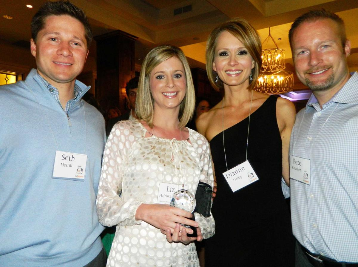KKTV news director Liz Haltiwanger, second from left, holds the Darcell Palmer Award for Integrity on Behalf of Children, from Kidpower of Colorado. She and her husband, Seth Merrill, left, have a 5-year-old daughter and have completed Kidpower's Starting Strong workshop. With them are KKTV anchor Dianne Derby and husband Pete Knudsen. 050314 Photo by Linda Navarro