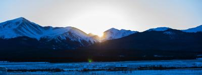 The sun sets over Colorado's highest mountain, 14,400-foot Mt. Elbert, left, Tuesday, Dec. 5, 2017, near Leadville, Colo. Elbert is part of the Sawatch Range.  (The Gazette, Christian Murdock) (copy)