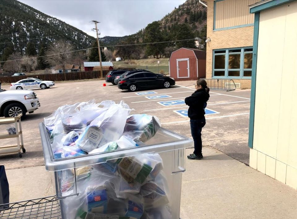 D-38 staff supports community need through meal distribution