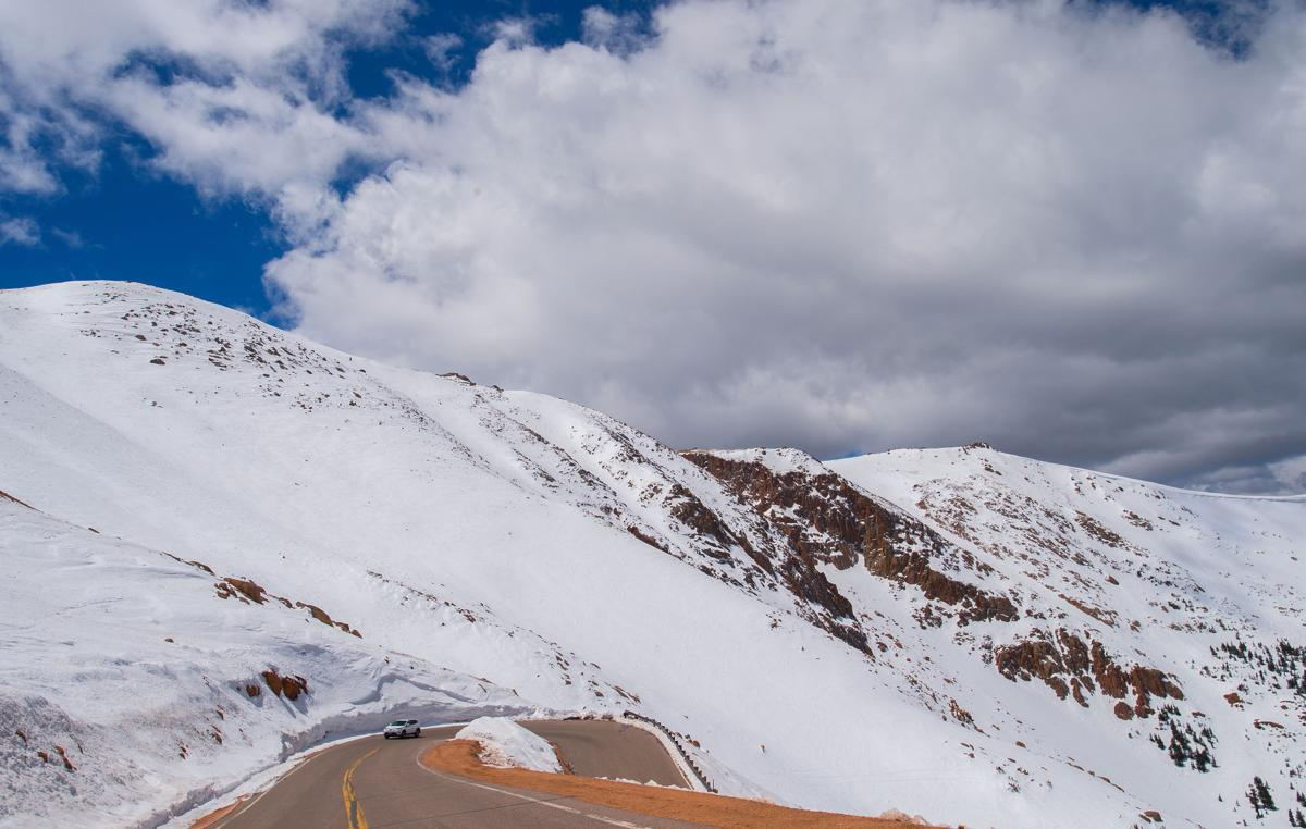 A car drives the Pikes Peak Highway above Glenn Cove toward the Devil's Playground to the top of 14,115-foot Pikes Peak after the road was reopened Monday, May 9, 2016. (The Gazette, Christian Murdock)